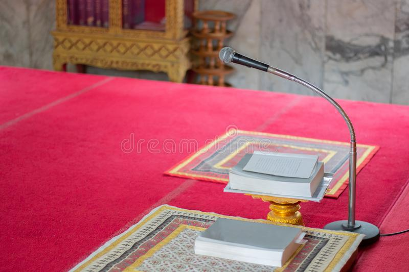 Microphone for people pray in church. Microphone and book for people pray in church , close up stock photos