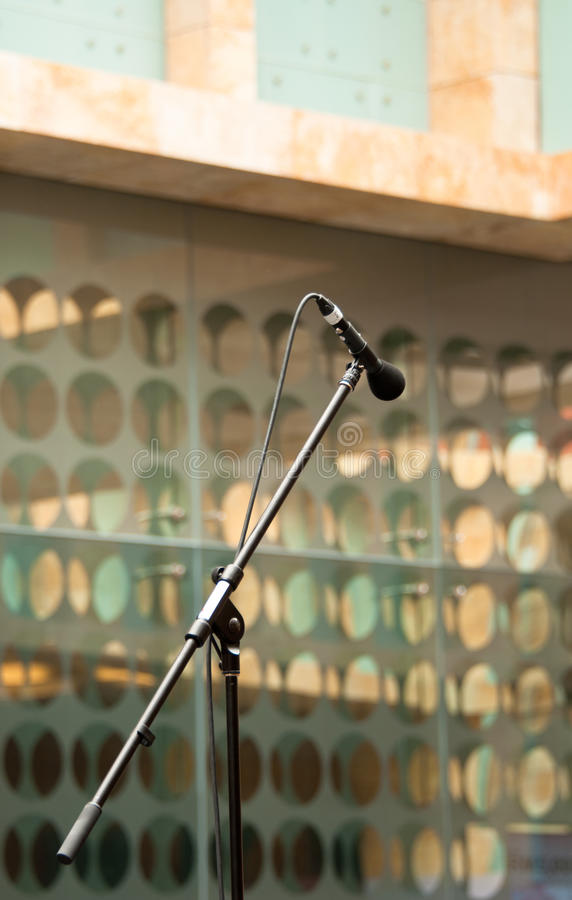 Microphone on Boom Arm. A portrait of microphone on a boom arm stand stock photography