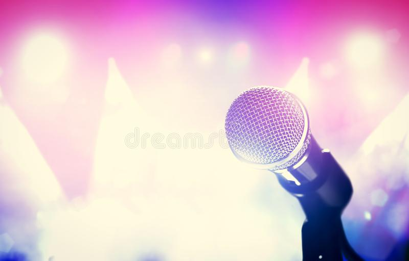 Microphone and bright colorful stage lights stock images