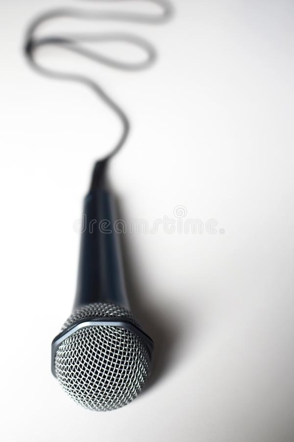 Microphone with cable on light grey background stock image