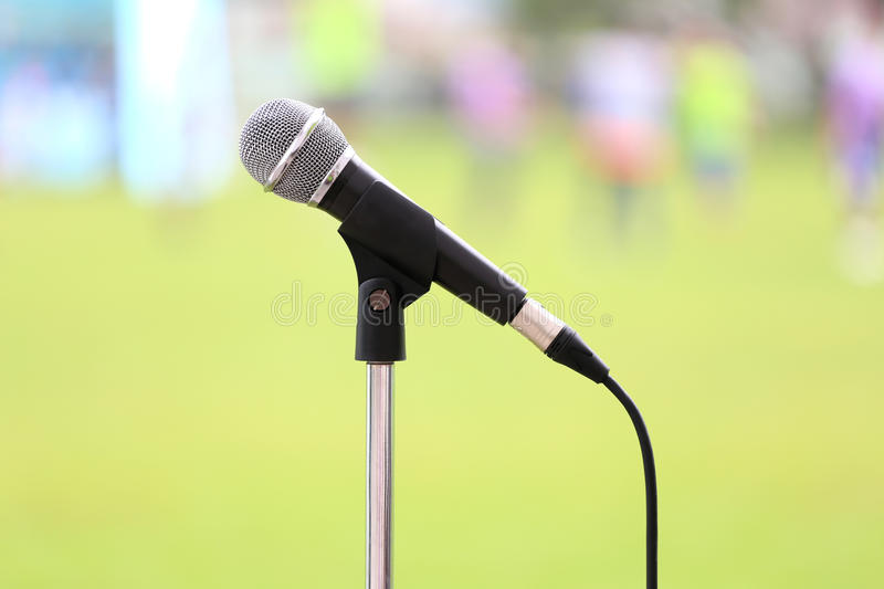 Microphone with cable and metal mesh in sound recording equipment. stock photo