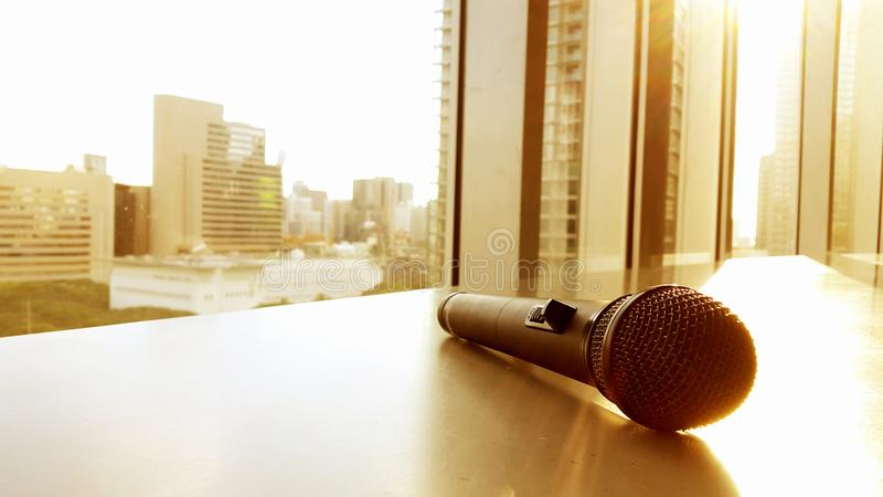 Microphone city background. A Microphone on city background stock photos