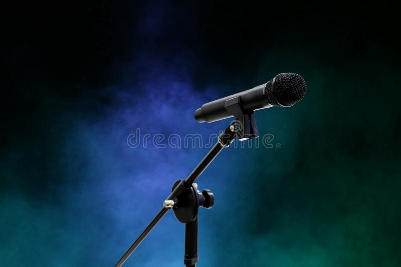 Microphone close up in dark night smoke. The Microphone close up in dark night smoke background selective focus stock photography