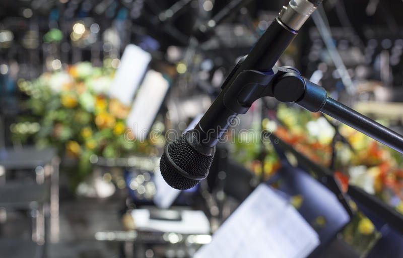 Microphone close-up on stage. Microphone on stage against a background of auditorium stock image