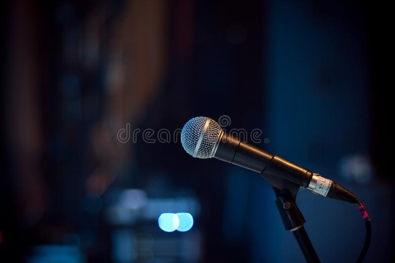 Microphone at concert hall. On blue background royalty free stock photo