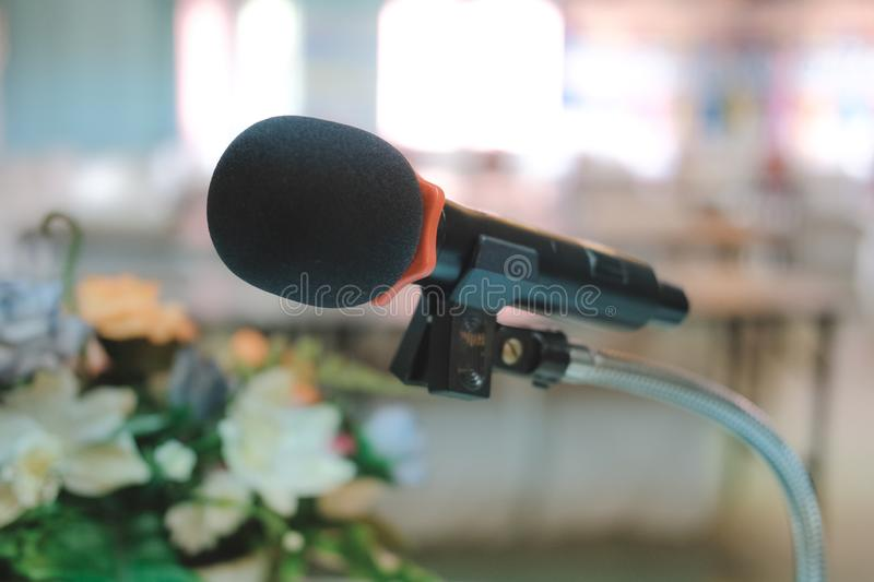 Microphone in conference hall interior. seminar room with empty seat. business event stock photos