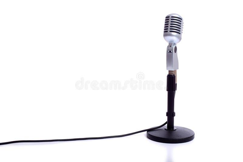 Microphone de cru sur le blanc photo stock