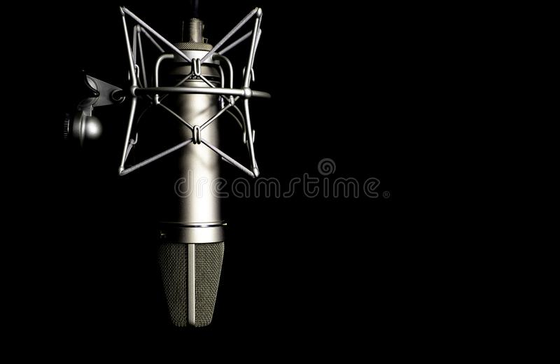 Microphone detail in music and sound recording studio, black background, closeup. Microphone detail in music and sound recording studio, black background royalty free stock image