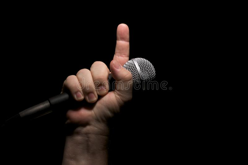 Microphone in Fist stock photos