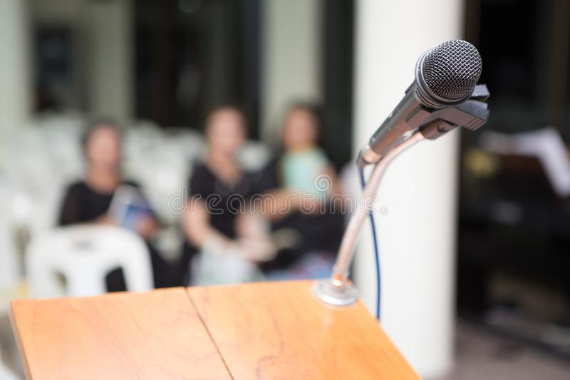 Microphone on the funeral podium and people wearing black in the church. Microphones on the funeral podium and people wearing black in the church royalty free stock images