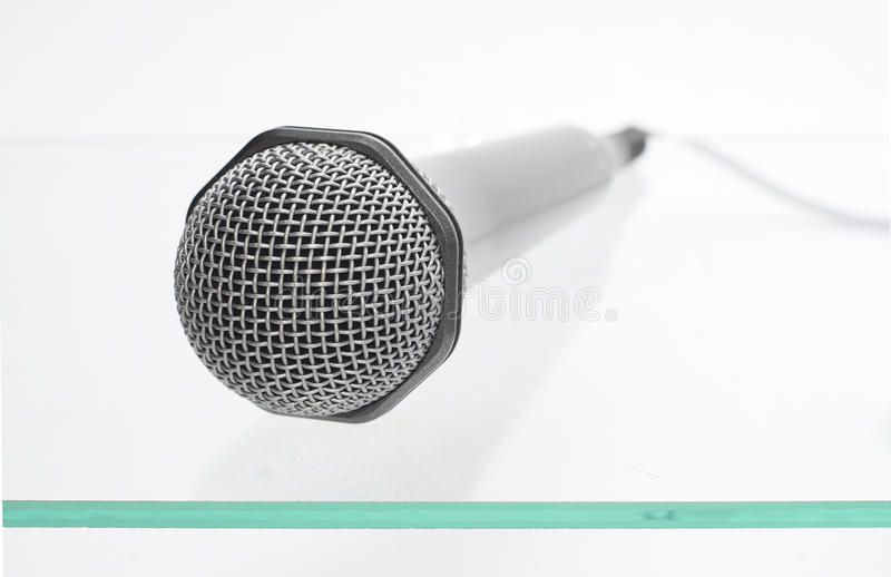 Microphone On The Glass Table Stock Image
