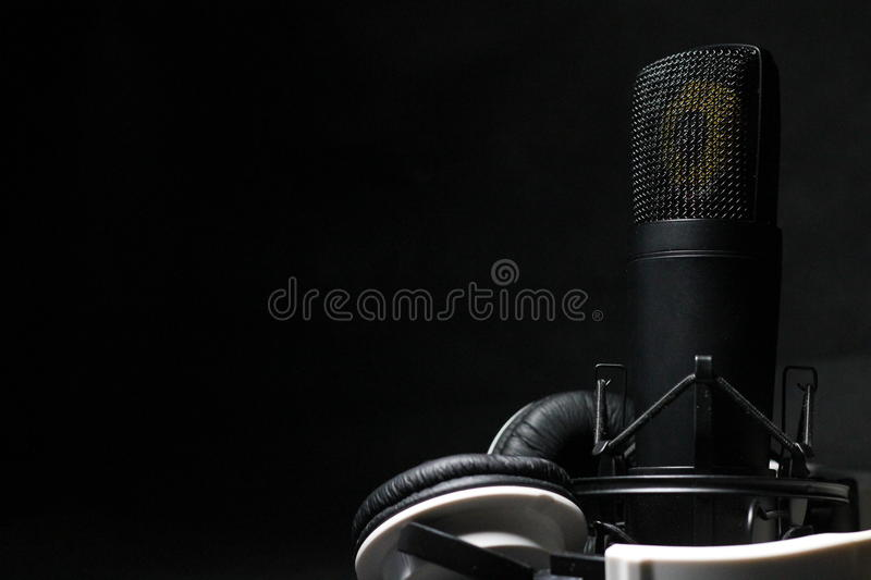 Microphone and headphones stock image