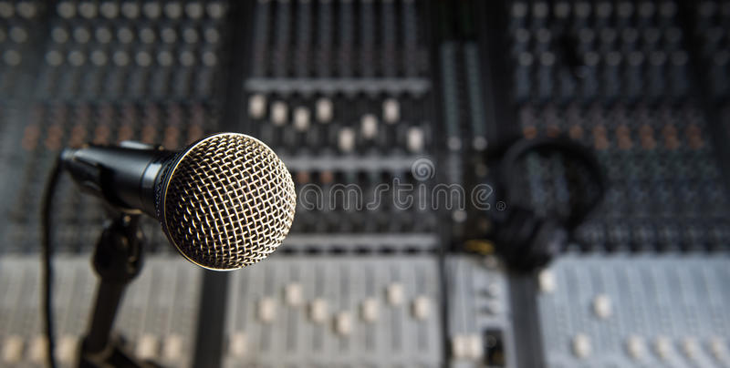 Microphone and Headphones on dirty sound mixer panel stock images