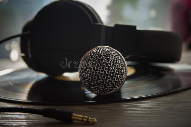 Microphone and headphones on vinyl record stock images