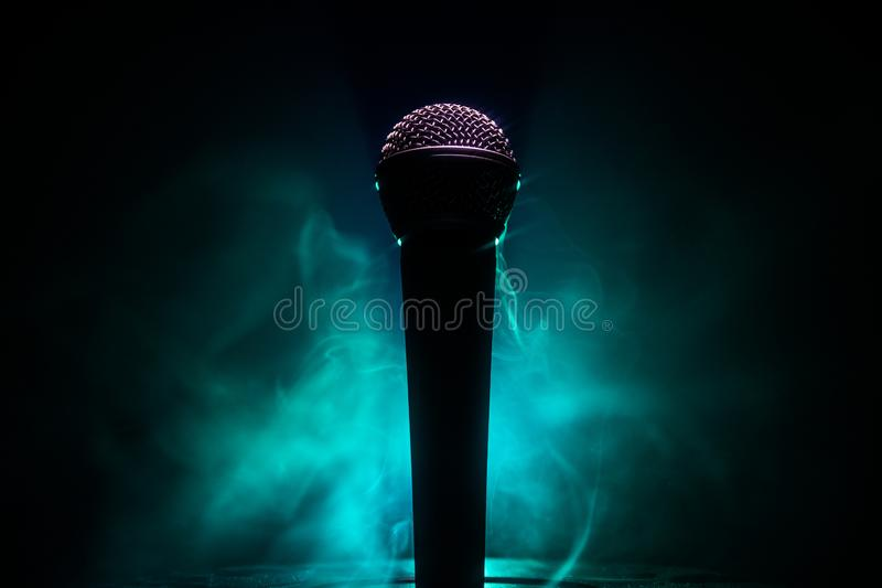 Microphone karaoke, concert . Vocal audio mic in low light with blurred background. Live music, audio equipment. Karaoke concert, stock photography