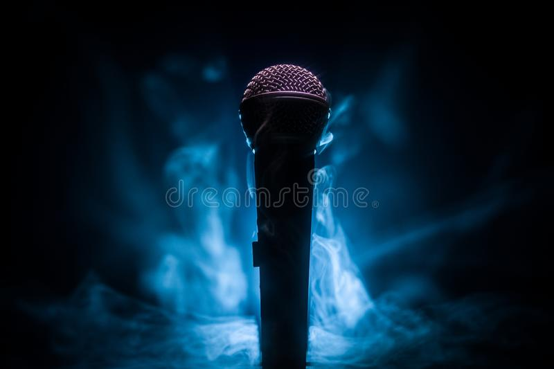 Microphone karaoke, concert . Vocal audio mic in low light with blurred background. Live music, audio equipment. Karaoke concert, royalty free stock images