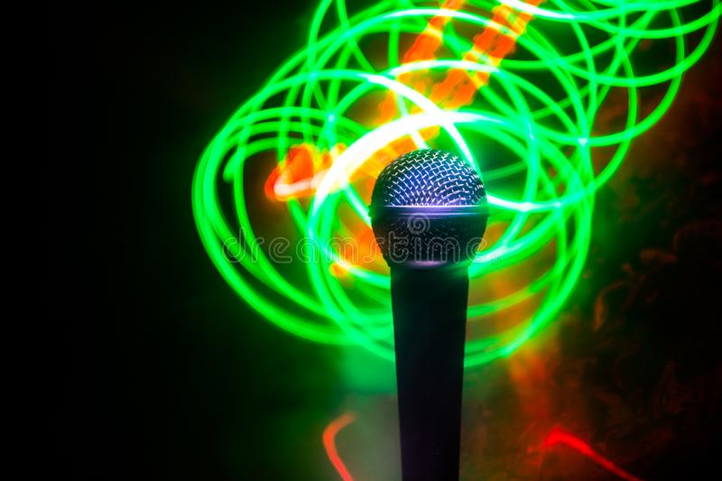 Microphone karaoke, concert . Vocal audio mic in low light with blurred background. Live music, audio equipment. Karaoke concert, stock photos