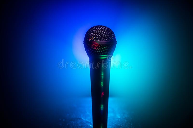 Microphone karaoke, concert . Vocal audio mic in low light with blurred background. Live music, audio equipment. Karaoke concert, royalty free stock photos