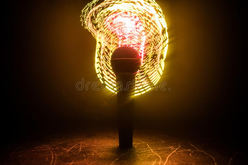 Microphone karaoke, concert . Vocal audio mic in low light with blurred background. Live music, audio equipment. Karaoke concert, stock photo