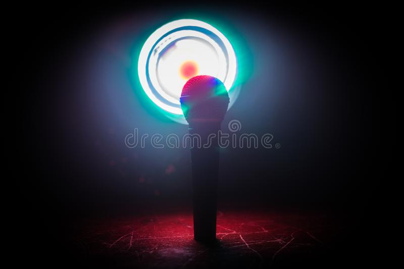 Microphone karaoke, concert . Vocal audio mic in low light with blurred background. Live music, audio equipment. Karaoke concert, royalty free stock photo