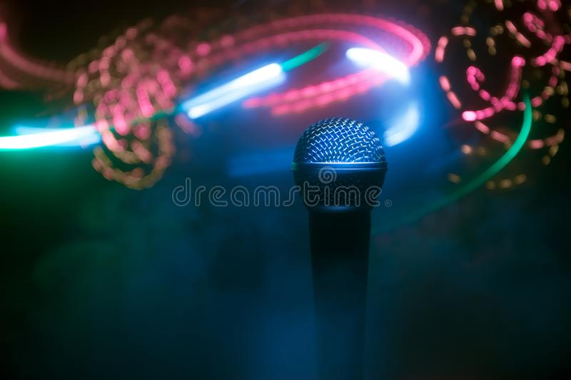 Microphone karaoke, concert . Vocal audio mic in low light with blurred background. Live music, audio equipment. Karaoke concert, royalty free stock photography