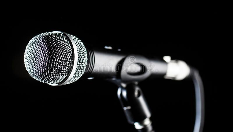 Microphone, mic, karaoke, concert, voice music. Vocal audio mic on a bleck background. Singer in karaokes, microphones royalty free stock image