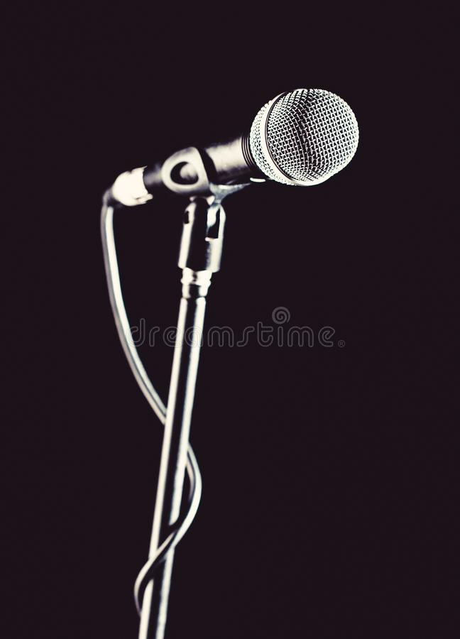 Microphone, mic, karaoke, concert, voice music. Closeup microphone. Vocal audio mic on a bleck background. Singer in stock photography