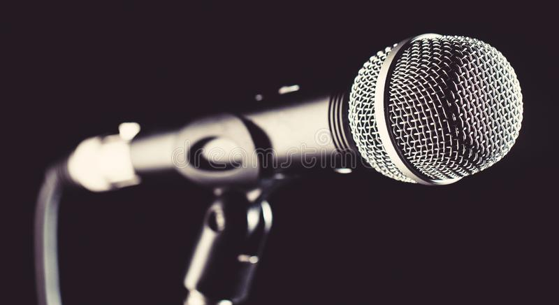Microphone, mic, karaoke, concert, voice music. Vocal audio mic on a bleck background. Singer in karaokes, microphones royalty free stock photography