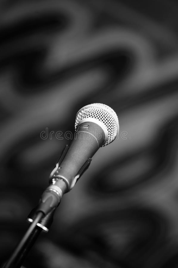 Microphone. Fixed on a rack, a black-and-white vertical photo. Shallow Depth of Field royalty free stock photography