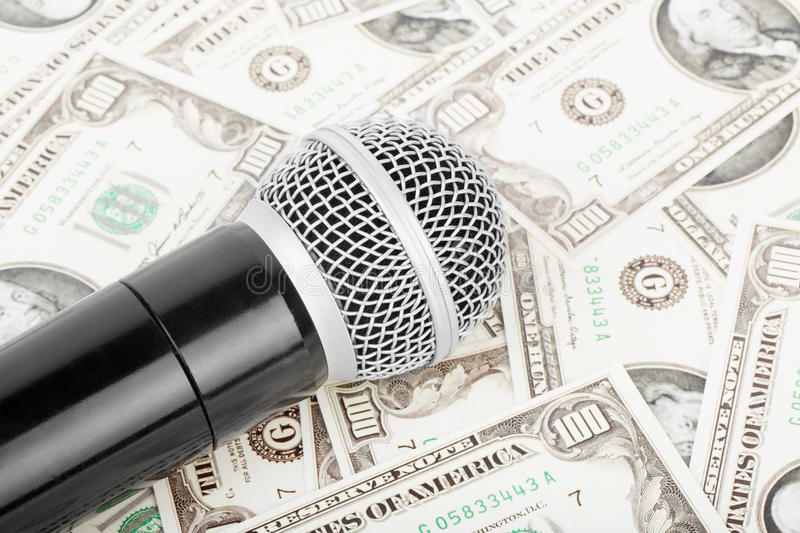 Microphone And Money Royalty Free Stock Images