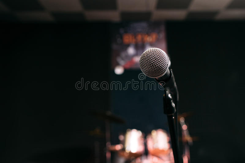 Microphone in music studio black background royalty free stock image