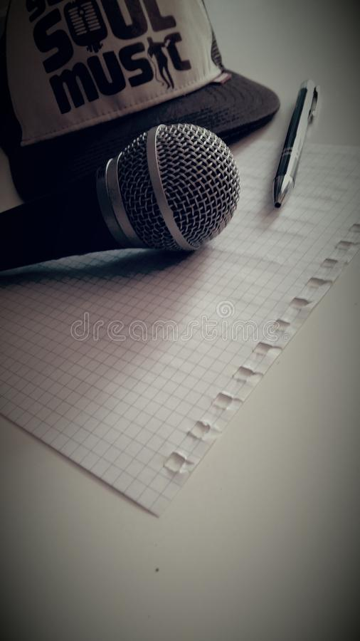 Microphone Near Click Pen Near Graphing Paper royalty free stock photos