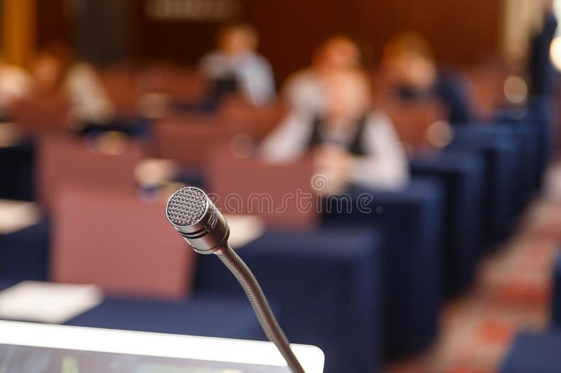 Microphone over conference hall background, Business meeting concept stock photography