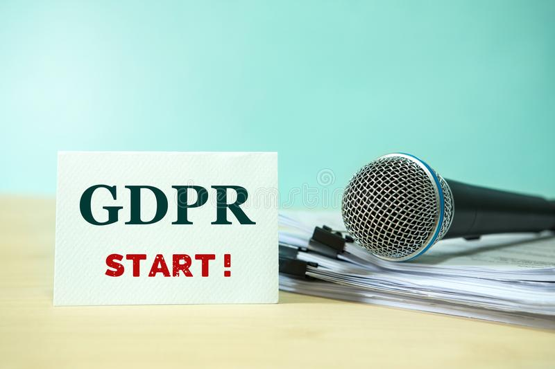 Close up Microphone on paper document with GDPR START text, concept of announce for preparation to implement GDPR (General Data P stock photos