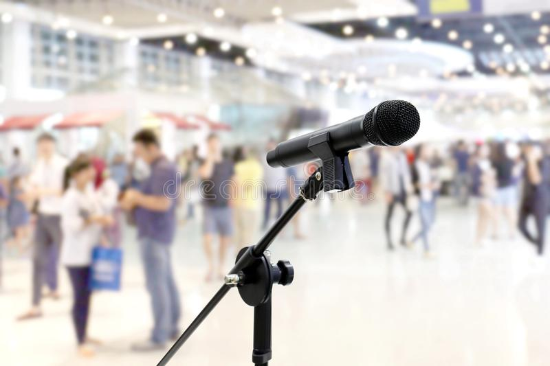 Microphone public relations on Blurred many People within Department store Shopping Mall Event hall inside background. The Microphone public relations on Blurred stock photography