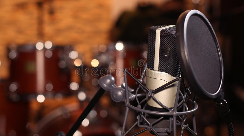 Microphone. In a recording studio stock images