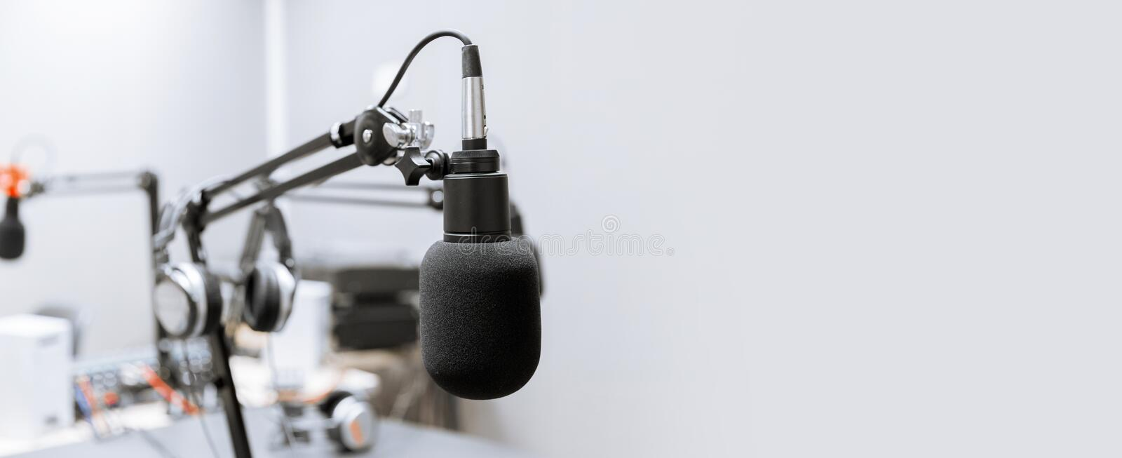 Microphone at recording studio or radio station. Technology and audio equipment concept - microphone at recording studio or radio station royalty free stock image