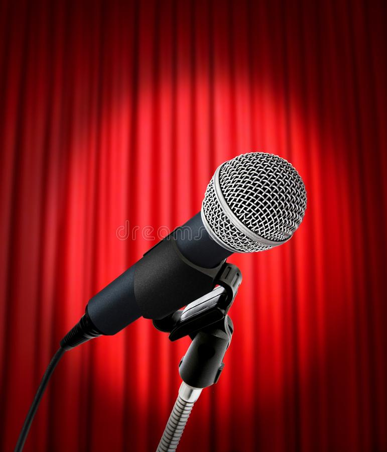 Microphone And Red Curtain Stock Photos