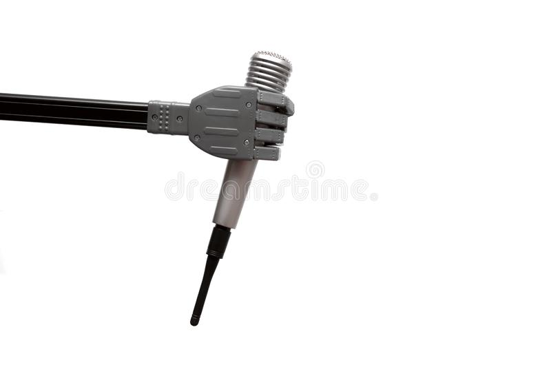 Microphone in the robot hand. Toy robot hand is holding a radio microphone isolated on the white background stock photo