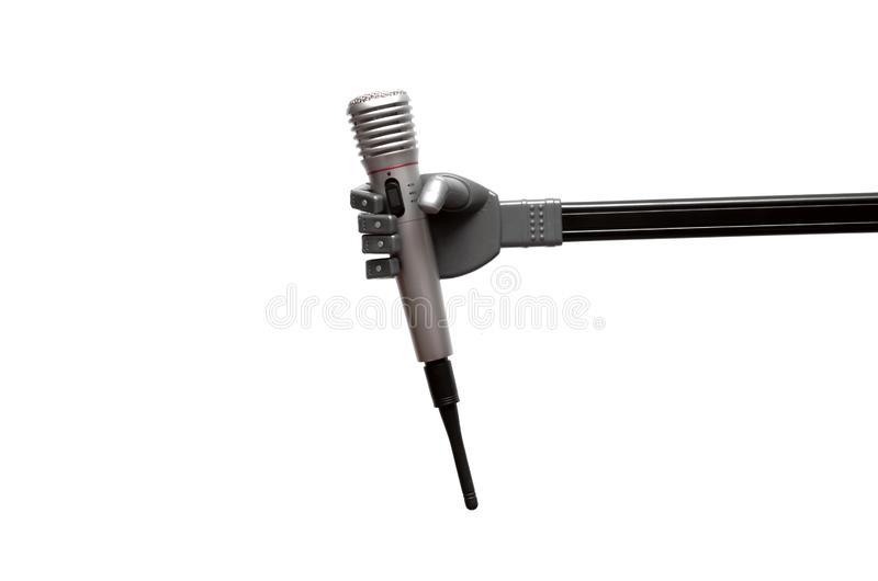 Microphone in the robot hand. Toy robot hand is holding a radio microphone isolated on the white background stock images