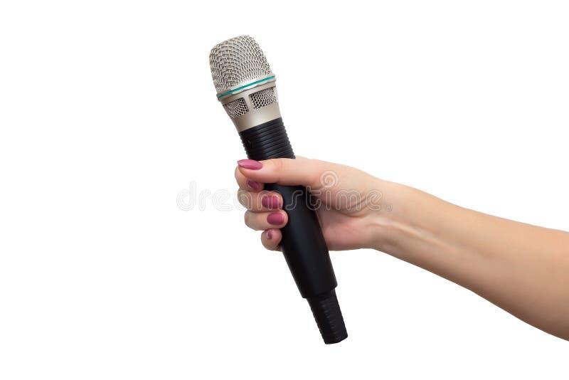 Microphone sans fil dans une main photos libres de droits