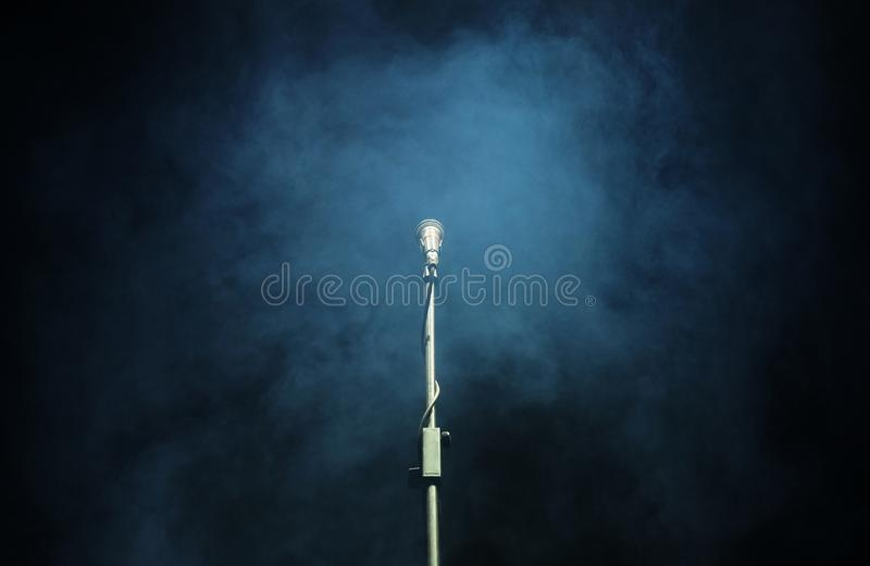 Microphone in a smoke on a dark background. In club royalty free stock photography
