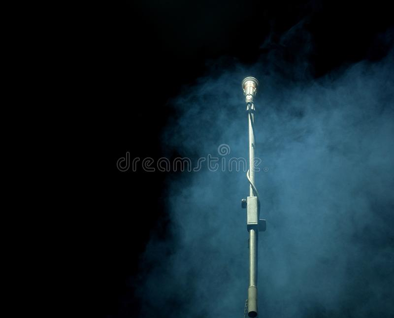 Microphone in a smoke on a dark background. In club royalty free stock photos