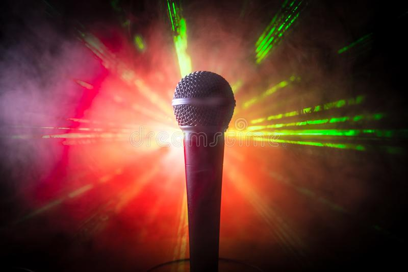 Microphone karaoke, concert . Vocal audio mic in low light with blurred background. Live music, audio equipment. Karaoke concert, stock images