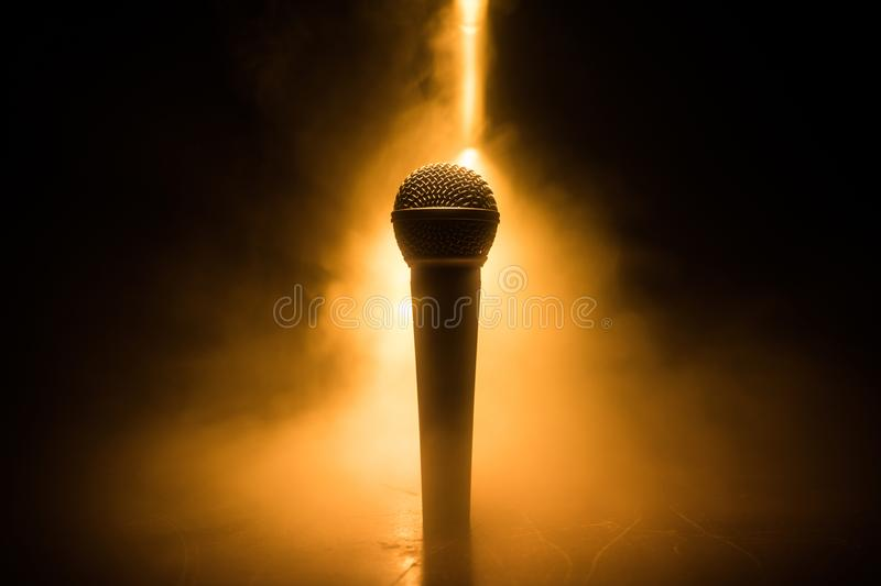 Microphone karaoke, concert . Vocal audio mic in low light with blurred background. Live music, audio equipment. Karaoke concert, royalty free stock image