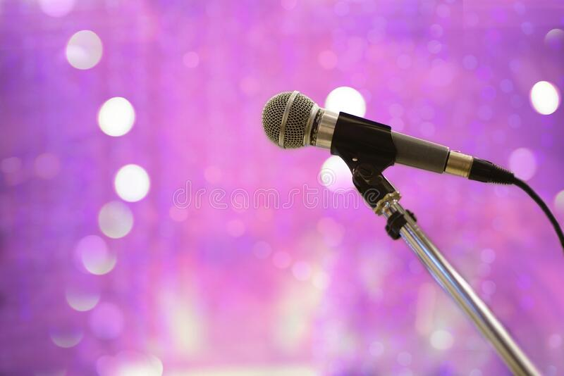 Microphone for speaking, speech or sing in studio, seminar room, conference hall or event concert night club. Microphone for speaking, speech or sing in studio stock images