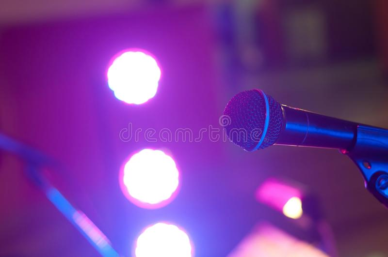 Microphone and spotlight in concert hall or conference room stock photography