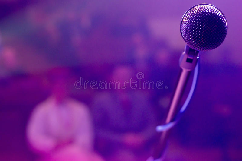 Microphone on stage. Concert microphone with stage lighting background royalty free stock images