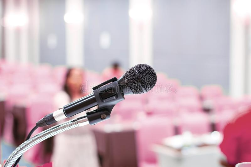 Microphone on stage with conference hall blurred pink background stock photos