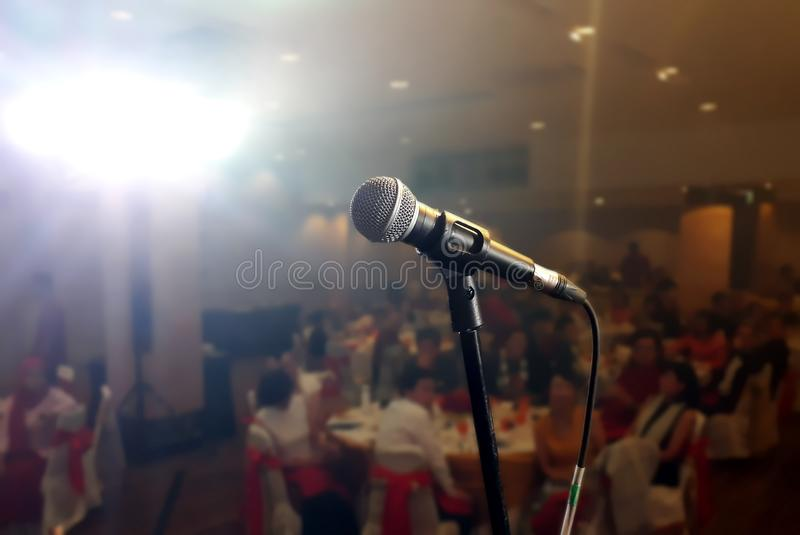 Microphone on stage under spotlight royalty free stock photo